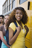 Teenage Girls Getting On School Bus Royalty Free Stock Images