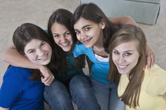 Teenage girls with girlfriends at home Stock Image