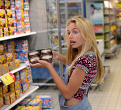 Teenage girls in grocery store Royalty Free Stock Images