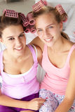 Teenage girls with hair in curlers Royalty Free Stock Image