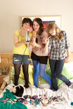 Teenage Girls Hanging Out In Untidy Bedroom Stock Images