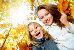 Teenage Girls Having Fun. Beautiful Teenage Girls Having Fun in Autumn Park Royalty Free Stock Photos