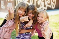 Teenage girls having fun Stock Images