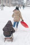 Teenage girls having fun in the deep snow during winter blizzard Royalty Free Stock Photography