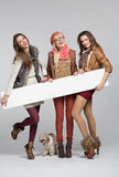 Teenage girls having fun with empty board Royalty Free Stock Image