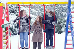 Teenage girls having fun in the snow on beautiful winter day Royalty Free Stock Image