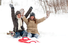 Teenage girls having fun in the thick snow Royalty Free Stock Images