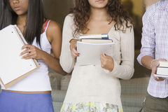 Teenage girls holding books. Stock Photography