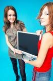 Teenage Girls Holding Monitor stock photos