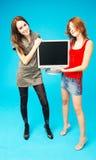 Teenage Girls Holding Monitor 2 royalty free stock image