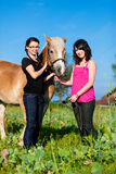 Teenage girls with horse Stock Photo
