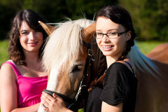 Teenage girls with horse Stock Photos