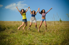 Teenage girls jumping on summer field Royalty Free Stock Images