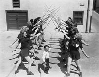 Teenage girls and little boy fencing Stock Images