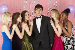 Teenage Girls Looking At Attractive Boy Stock Photography
