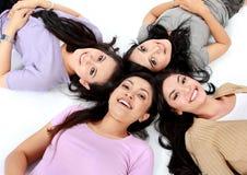 Teenage girls lying on white floor Stock Photo