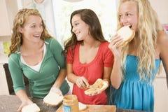Teenage Girls Making Sandwiches Stock Photography