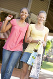 Teenage Girls Out Shopping. Smiling Royalty Free Stock Photos