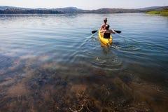 Teenage Girls Paddling Canoe Stock Photo