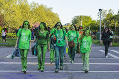Teenage girls painted with green powder. Group of teenage girls covered in green colored powder smiling at the Color Run event on April 26 in Bucharest, Romania Stock Photography