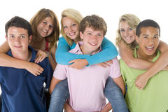 Teenage Girls Piggy Back On Boys Stock Photos