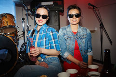 Teenage Girls Posing in Night Club Royalty Free Stock Image