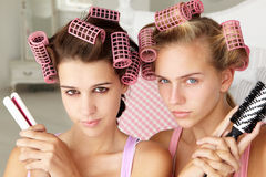 Teenage girls pulling a pose with beauty equipment Royalty Free Stock Photo