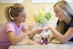 Teenage girls putting on nail polish Royalty Free Stock Photography