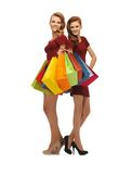 Teenage girls in red dresses with shopping bags Royalty Free Stock Photography