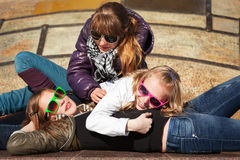 Teenage girls relaxing on the city street Stock Image