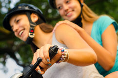 Teenage girls riding motorcycle Royalty Free Stock Images