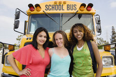 Teenage Girls By School Bus Royalty Free Stock Photos