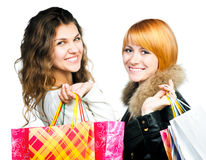 Teenage girls with shopping bags Royalty Free Stock Image