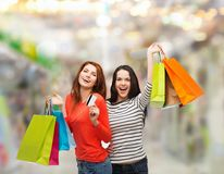 Teenage girls with shopping bags and credit card Royalty Free Stock Photography