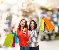 Teenage girls with shopping bags and credit card Stock Photography