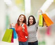 Teenage girls with shopping bags and credit card Stock Image