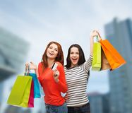 Teenage girls with shopping bags and credit card Royalty Free Stock Photo