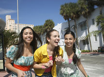 Teenage Girls With Shopping Bags Crossing Street Stock Images