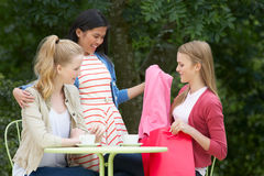 Teenage Girls With Shopping Bags At Outdoor cafe Stock Image