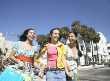 Teenage Girls With Shopping Bags Walking On Street Stock Photography