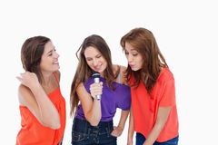 Teenage girls singing in a microphone Royalty Free Stock Photography