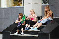 Teenage girls sitting on the school steps Royalty Free Stock Photography