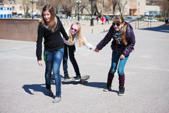 Teenage girls with skateboard Royalty Free Stock Photos