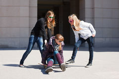 Teenage girls with skateboard Royalty Free Stock Photo