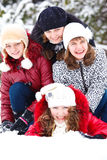 Teenage girls in a snowy park Royalty Free Stock Photos