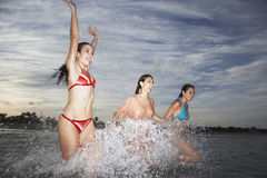 Teenage Girls Splashing In Sea Royalty Free Stock Images