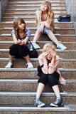 Teenage girls on a steps Stock Image
