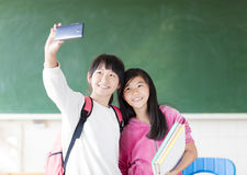 Teenage girls student make selfie on the phone. Stock Images