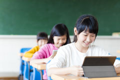 Teenage girls student watching the tablet in classroom Royalty Free Stock Images