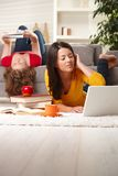 Teenage girls studying at home Stock Images